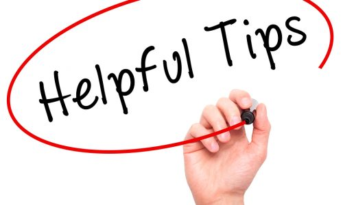 Man hand writing Helpful Tips on visual screen. Business,help, internet, technology concept.
